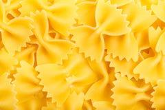 Closeup of Uncooked Italian Pasta - Farfalle. Italian macaroni farfale background close-up top view stock images