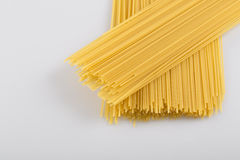 Closeup of uncooked spaghetti noodles. Spaghetti isolated on white background stock photos