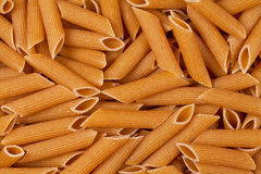 Closeup of uncooked wholewheat pasta Stock Photography