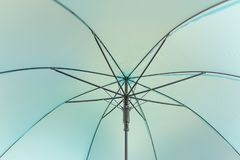 Closeup under soft blue umbrella and black steel frame background.  royalty free stock photos