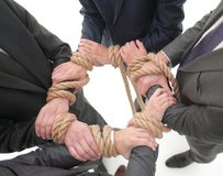 Closeup.unified business team ,tied a strong rope. The concept of unity Royalty Free Stock Photo