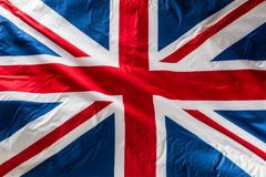 Closeup of Union Jack flag. UK Flag. British Union Jack flag blo. Wing in the wind stock image