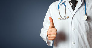 Closeup Unrecognizable Man Doctor Showing Thumbs Up. Gesture Healthcare People Medicine Concept. Unrecognizable male doctor in a white lab coat with a Royalty Free Stock Images