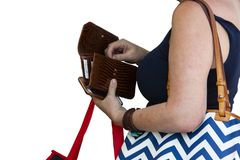 Closeup of unrecognizable woman holding shopping bags opening billfold to get out money for purchase isolated on white room for co stock photography