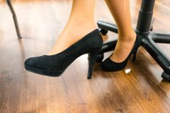 Closeup of unrecognizable woman leg wearing high heels Royalty Free Stock Photo
