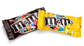 Closeup of unwrapped M&M`s milk chocolate stock images