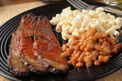 Closeup up of beef brisket with baked beans Stock Image