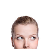 Closeup of the upper part of a curious womans face Stock Images
