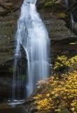 Closeup of upper waterfall and fall foliage at Kent Falls. Royalty Free Stock Image