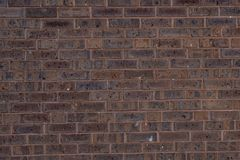 Rough Ruddy Brick Texture Background. Closeup urban rough red brick wall abstract texture background with detail Royalty Free Stock Photos