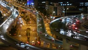 Closeup of urban traffic on overpass interchange at night,time lapse. stock video