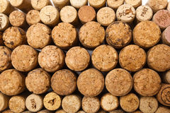 Closeup of used wine corks. Closeup of a wall of used wine corks. A random selection of used wine corks, some with vintage years Stock Photo