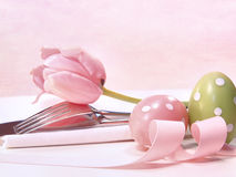 Closeup of utensils and pink tulip on pink Stock Photo