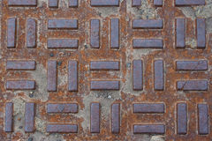 Closeup of Utility Cover on Street. Pattern and texture of a metal utility access cover in the street. Ideal for a background royalty free stock image