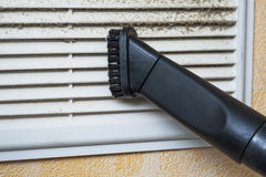 Closeup of vacuum cleaner pipe and ventilation grill Royalty Free Stock Photography