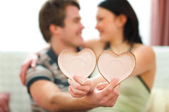 Closeup on Valentines hearts in hands of couple Stock Photo