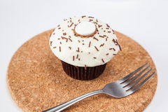 Closeup vanilla cream cupcake with chocolate sprinkle Royalty Free Stock Images