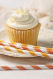 Closeup of vanilla cupcake with straws Royalty Free Stock Image