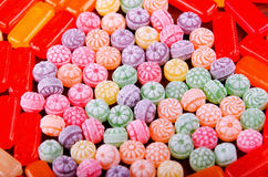 Closeup variation of colorful hard candy lying mixed as seen from above Royalty Free Stock Photo