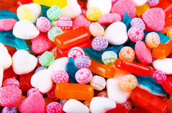 Closeup variation of colorful hard candy lying mixed as seen from above Stock Image