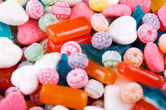 Closeup variation of colorful hard candy lying mixed as seen from above Royalty Free Stock Photos