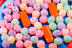 Closeup variation of colorful hard candy lying mixed as seen from above Stock Photography