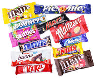 Closeup of various chocolate bars on white royalty free stock image