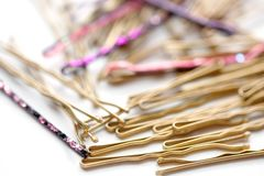 Closeup of Various Decorative Bobby Pins royalty free stock photos