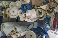 Closeup of various fabric bolts Royalty Free Stock Photos