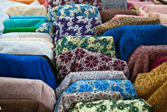 Closeup of various fabric bolts in store Royalty Free Stock Image