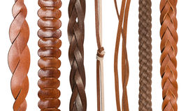 Closeup of various leather belts. Closeup of various brown leather belts isolated on white background royalty free stock photos