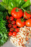 Closeup of vegetable groceries on the wooden kitchen table Stock Photography