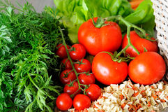 Closeup of vegetable groceries on the wooden kitchen table Stock Photos