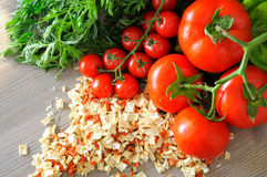 Closeup of vegetable groceries on the wooden kitchen table Royalty Free Stock Photography