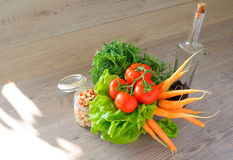 Closeup of vegetable groceries on the wooden kitchen table Royalty Free Stock Photo