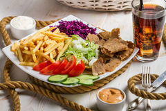 Closeup of vegetables, fries and meat kebab Stock Photo