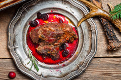 Closeup on venison served with cranberry sauce Stock Photo
