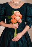 Closeup victorian woman holding roses Royalty Free Stock Photo