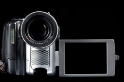 Closeup of video camera on black with blank screen. Cloeup of video camera on black background with screen open facing forward royalty free stock photo