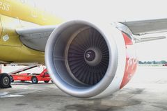 Closeup view of Air Asia engine plane Royalty Free Stock Photography