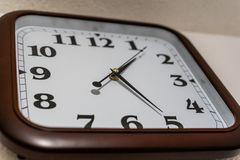 Closeup view of Analog Clock on the Wall with Brown Frame - Concept of Deadline. And Business Hours stock photos