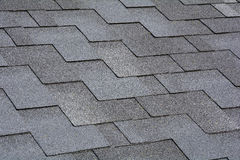 Closeup view on Asphalt Roofing Shingles Background. Roof Shingles - Roofing. Royalty Free Stock Images