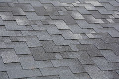 Closeup view on Asphalt Roofing Shingles Background. Roof Shingles - Roofing. Stock Photography