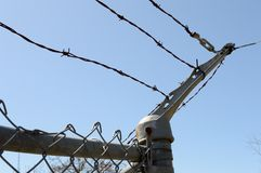 Barb Wire Fence. Closeup view of a barb wire fence for border control and private property protection Stock Photos