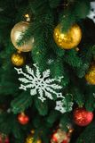 Christmas tree decorated with bright golden and red balls Royalty Free Stock Images