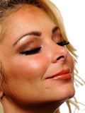 Closeup view of a blond model with her eyes closed. Royalty Free Stock Photography