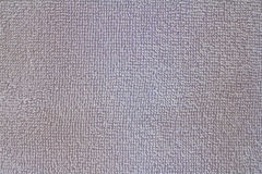 Closeup view of blue towel. Fluffy white background Royalty Free Stock Images