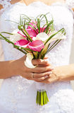 Closeup view of bride holding bouquet of callas Royalty Free Stock Image
