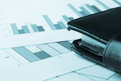 Closeup view of business charts and a notebook Stock Image