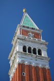 Closeup View of the Campanile in St Mark's Square. Close up view of the beautiful campanile or bell tower on Venice's picturesque waterfront Royalty Free Stock Image